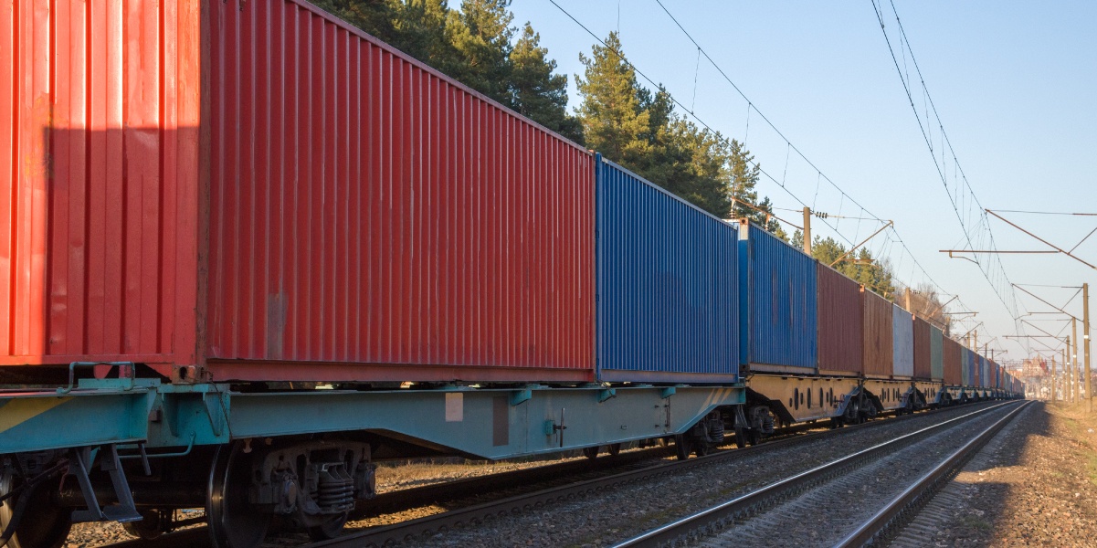 Cargo containers transportation on freight train by railway