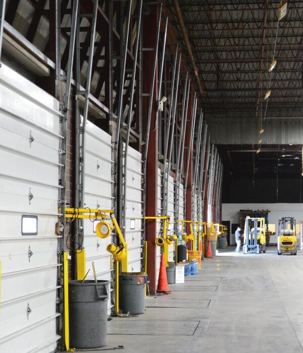 Interior row of loading docks inside of warehouse building