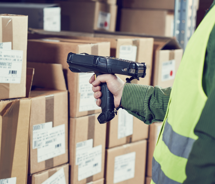 Warehouse worker with RF barcode scanner, using Warehouse Management System