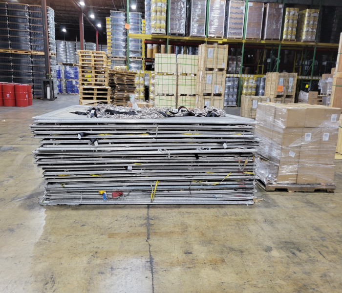 Palletized Items on floor, Stacked pallets on warehouse shelves in background