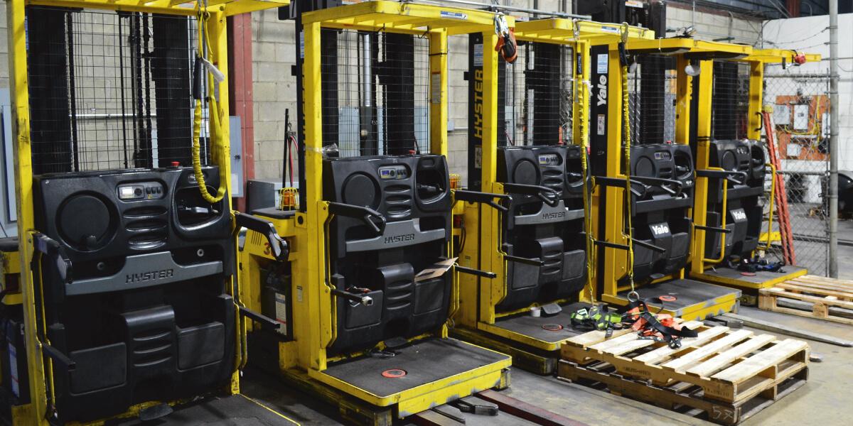 Yellow Pallet Handling Equipment in Warehouse