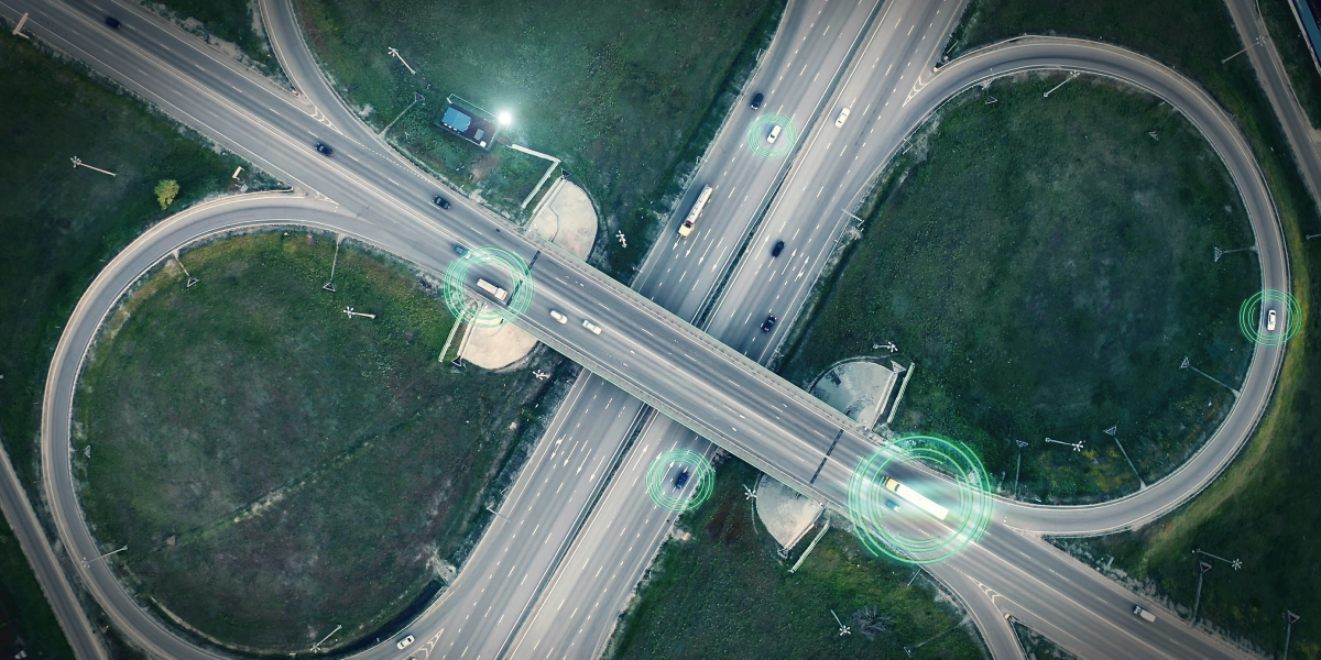 GPS navigation and autonomous driverless transportation concept. Aerial view of transport junction with cars and trucks driving with digital green circles, future global technology on roads.